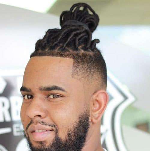 Fade on side with Dreadlock Bun