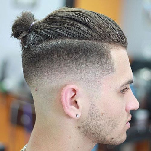 Fade with long on top and Ponytail