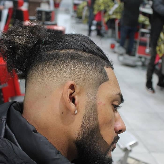 Low Fade with Long Slicked Back Hair on Top
