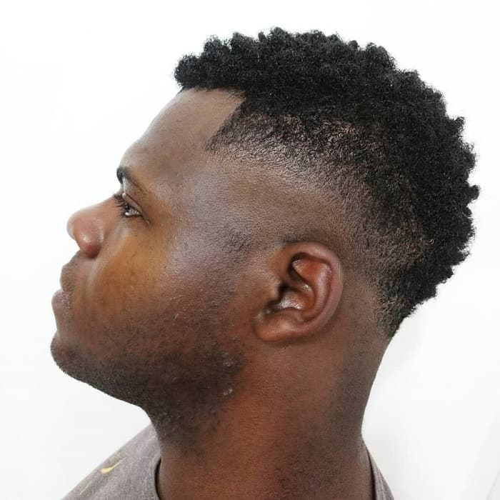 short afro mohawk with bald fade