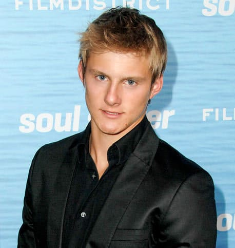 Image of Alexander Ludwig with hair pulled to the right side.