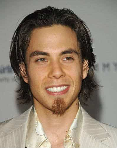 Photo of Apolo Anton Ohno medium length hairstyle.