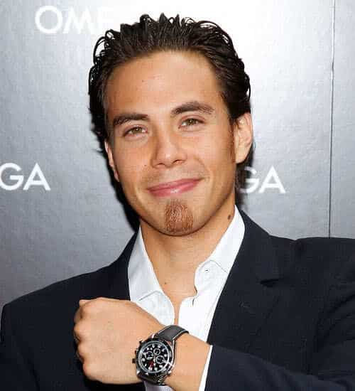 Picture of Apolo Anton Ohno swept back hairstyle.