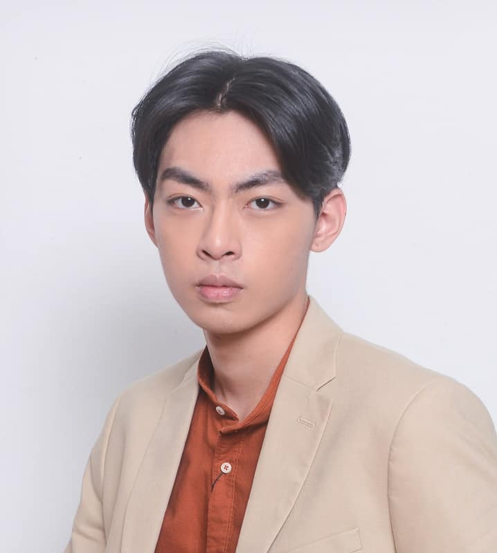Asian guy with middle parted hair