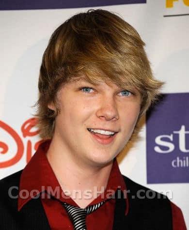 Photo of Austin Anderson shaggy hair.