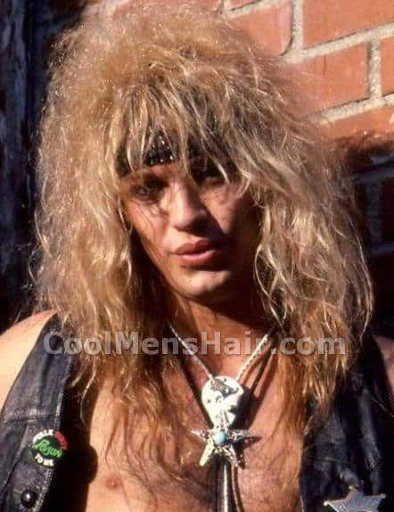 Picture of Bret Michaels big rock star hairstyle.
