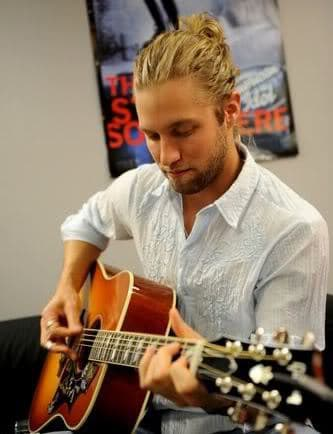 Casey James pulled back/ponytail hairstyle