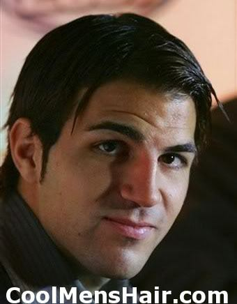 Photo of Cesc Fabregas side parted hairstyle.