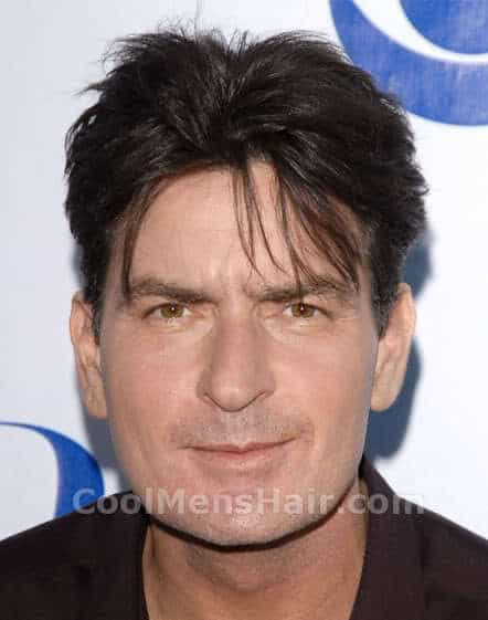Picture of Charlie Sheen middle part hairstyle.