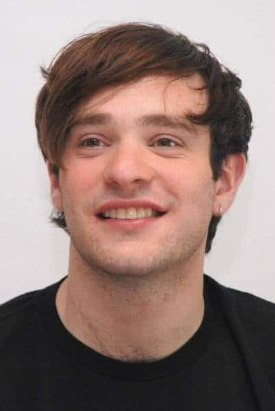 Side swept bangs hairstyle from Charlie Cox.