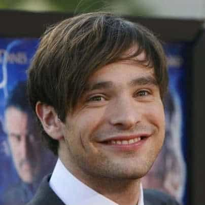Cool side swept bangs hairstyle from Charlie Cox.