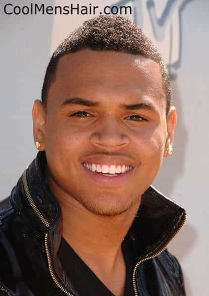 Photo of Chris Brown short black mohawk hairstyle for men.
