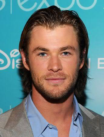 Pic of Chris Hemsworth comb back hairstyle.