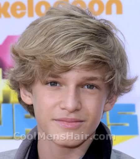 Cody Simpson blonde side bangs hair style.