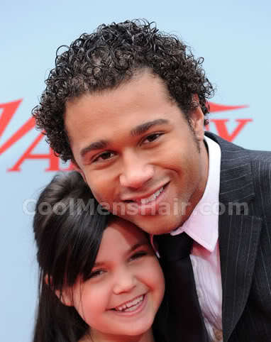 Image of Corbin Bleu short curly hairstyle for African American men.