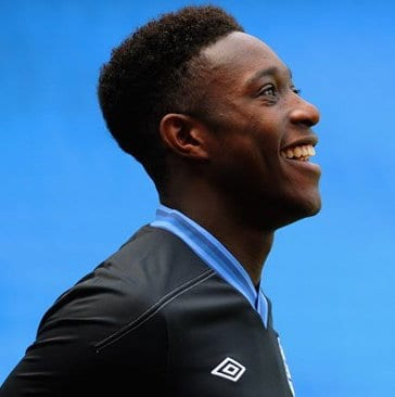 Photo of the side view of Danny Welbeck high top fade hairstyle.