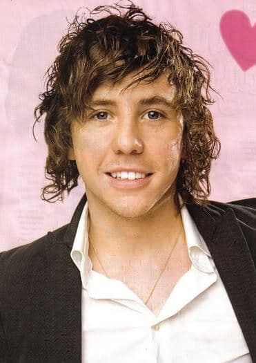 Photo of Danny Jones curly hairstyle for men.