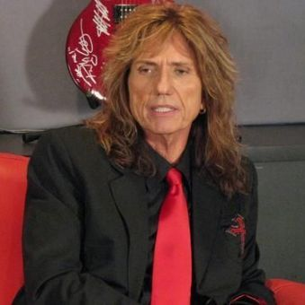 Photo of David Coverdale long hairstyle.
