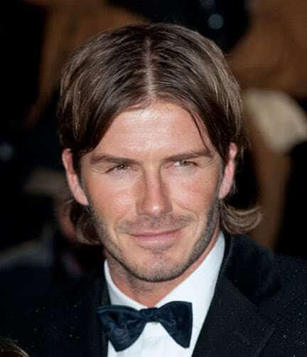 David Beckham center part hairstyle.