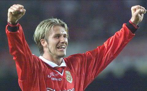 David Beckham blonde hairstyle with sideburns.