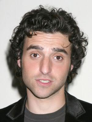 Picture of David Krumholtz medium length curly hair.