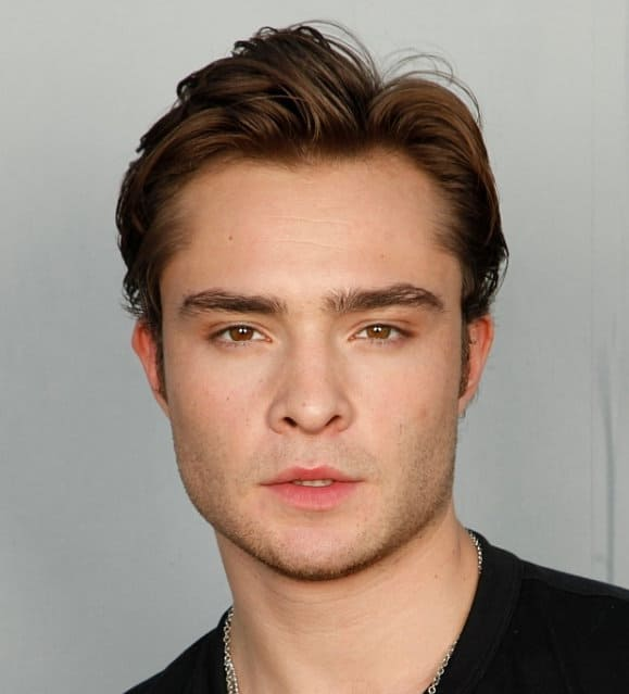 Photo of Ed Westwick flipped back hairstyle.