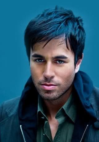 Photo of Enrique Iglesias bangs hairstyle.