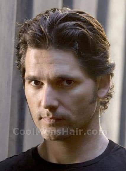 Image of Eric Bana longer curly hair.