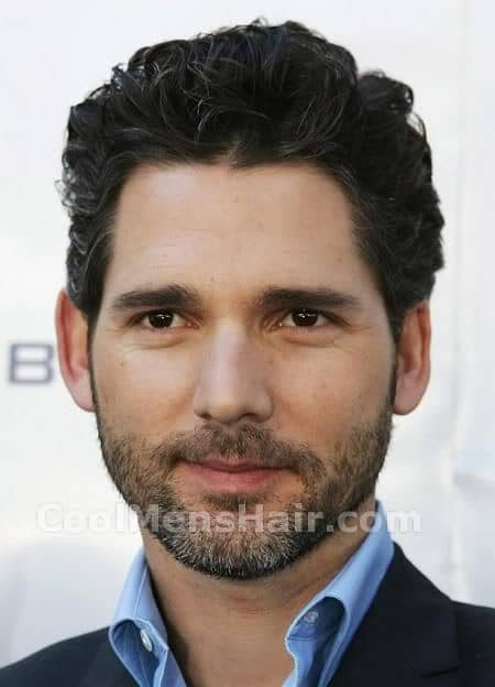 Picture of Eric Bana short curly hairstyle.