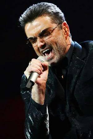 Image of George Michael slick back hairstyle.