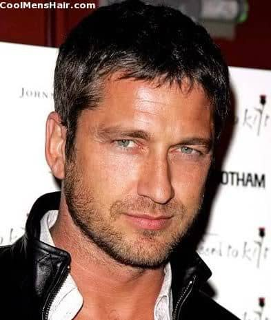 Gerard Butler caesar cut for men with large foreheads.