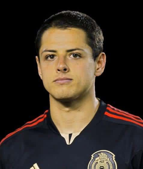 Photo of famous footballer Javier Chicharito Hernandez with short hair.