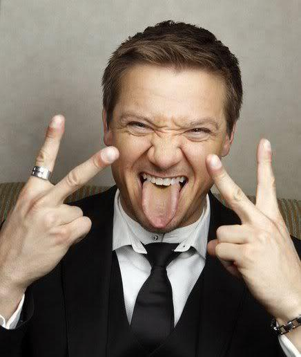 Photo of Jeremy Renner short hairstyle.
