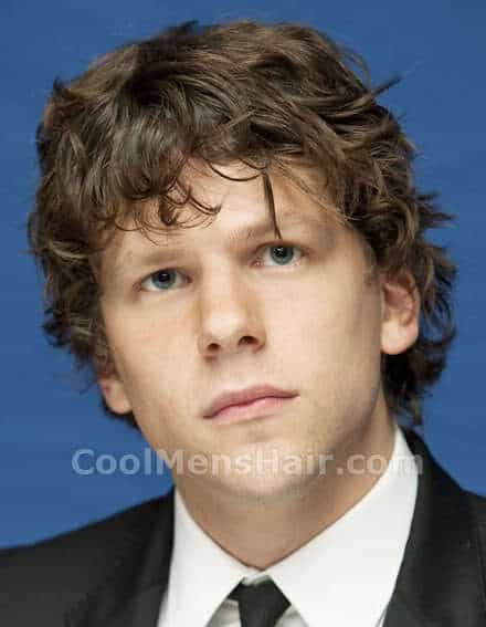 Photo of Jessie Eisenberg curly hairstyle with bangs.