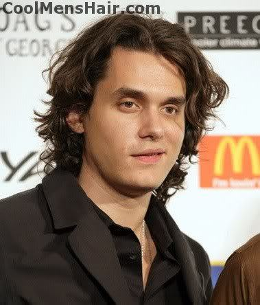 Photo of John Mayer natural curly hairstyle for men.