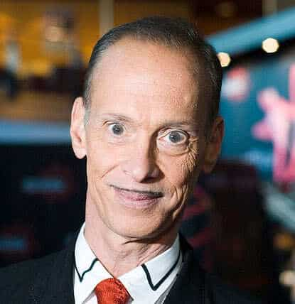 Photo of John Waters with pencil thin mustache.