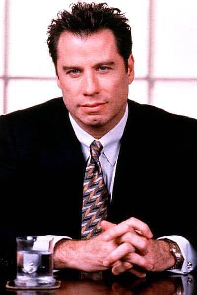 John Travolta hairstyle.