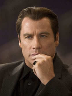 John Travolta's semi flat top hair.