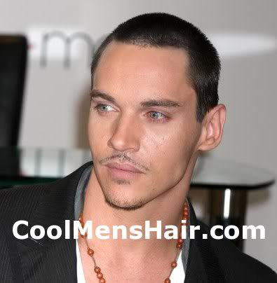 Picture of Jonathan Rhys Meyers buzz cut.