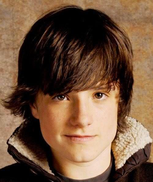Photo of Josh Hutcherson medium length shaggy hairstyle.