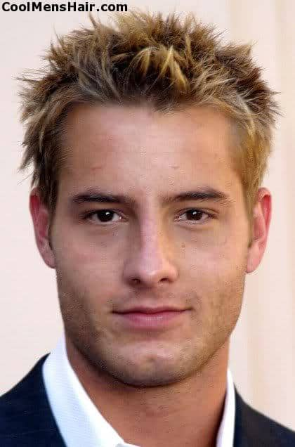 Photo of Justin Hartley spiky blonde hairstyle for men with thick hair.