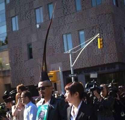 Photo of Kazuhiro Watanabe with the tallest mohawk hairstyle.