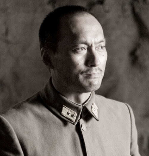 Photo of Ken Watanabe military hairstyle.