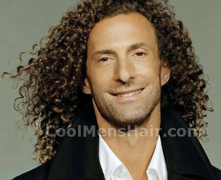 Photo of Kenny G long curly hairstyle.
