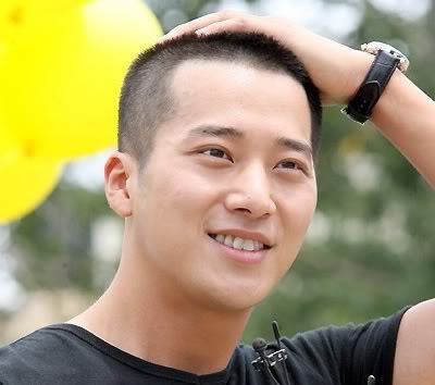 Photo of Lee Wan buzz cut hairstyle.