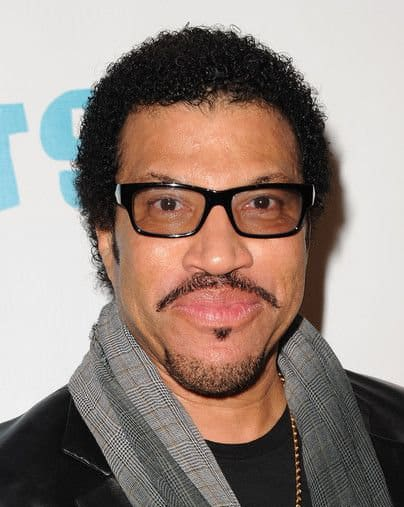 Photo of Lionel Richie hairstyle.