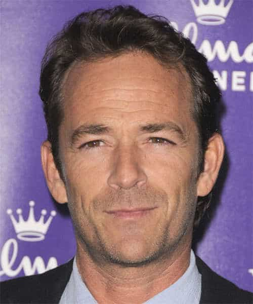 Photo of Luke Perry conservative hairstyle.