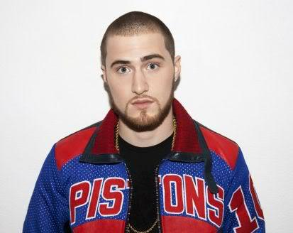 Photo of Mike Posner with cool buzz cut and beard style.