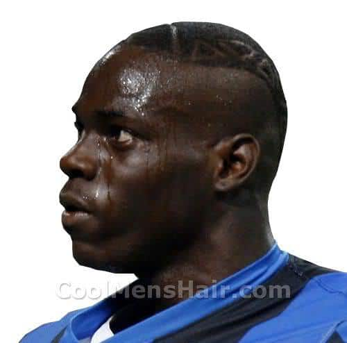 Pic of Mario Balotelli short mohawk hair with tattoo.