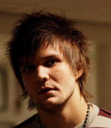 Martin Johnson messy hairstyle.
